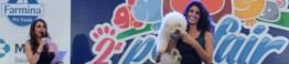 Pet Fair_Claudia Métne apresentando Dani Montuori e seu mascote Marley, um frison biché_d